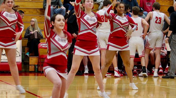 cheerleaders and basketball players